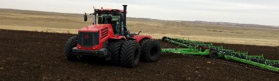 Трактор К 744 р4: Бороним карьерное поле