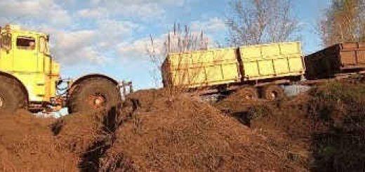 Трактор Кировец: с телегами за ячменём