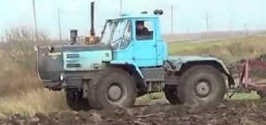 Трактор T-150 с плугом