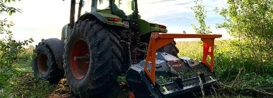 Трактор CLAAS ATLES 946 с мульчером TMC CANCELA