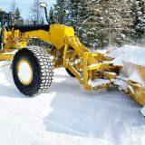 Грейдер на расчистке снега